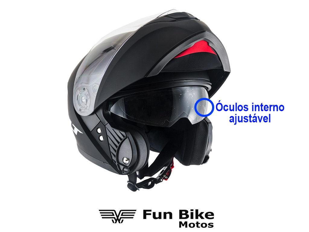 A imagem ostra um capacete com óculos interno ajustável.